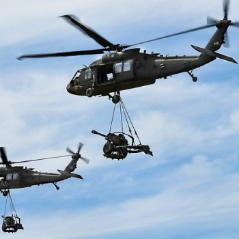 Military Helicopters Transporting Artillery
